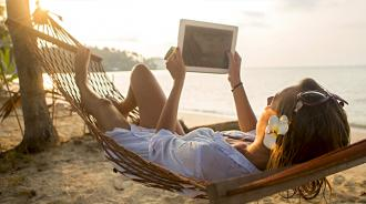 Girl on hammock with tablet