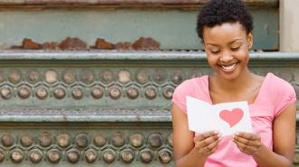 Lady reading Valentine's Day card